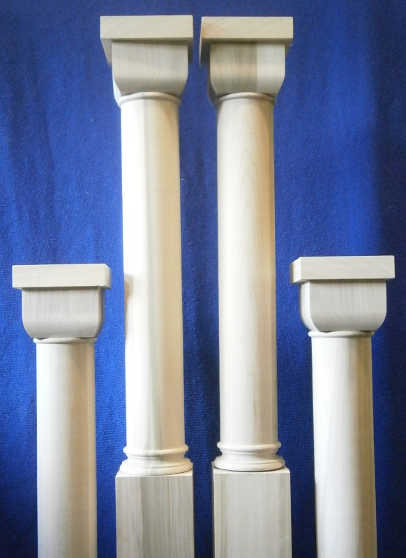 Tulipwood newel posts  with an unusual square section at the top.